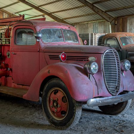 1930s red fire truck with ladder.