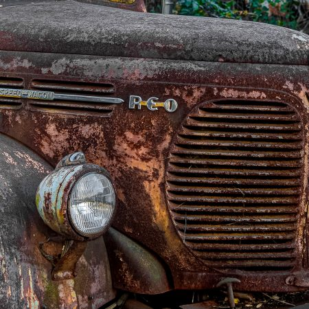Rusted and peeling classic REO Speedwagon truck.