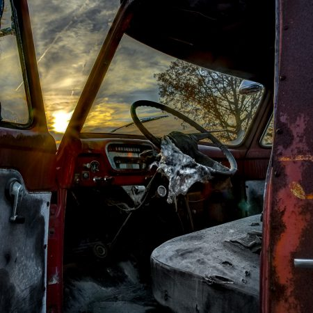 Sunset and the interior of a vintage 1950s truck cab.